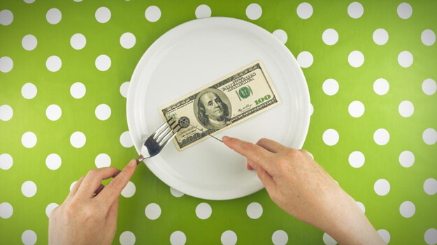 Photo of money on plate in HR trends blog