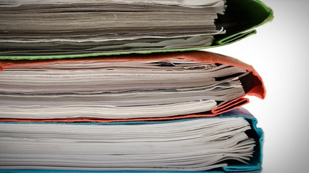 Picture of folders stacked to illustrate employee benefit audits in a HR trends blog
