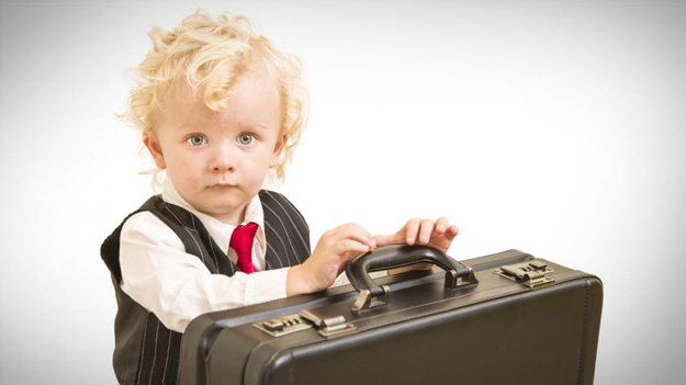 Photo of toddler dressed in business clothes with briefcase illustrating the need to address how generational changes impacting your business in a HR trends blog