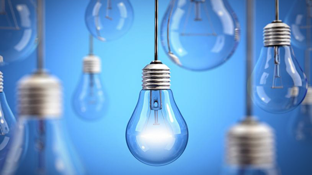 Photo of lightbulbs hanging on blue background to illustrate importance of making innovation successful in a HR trends blog