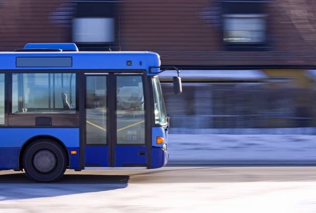 Public bus in motion to show the ease that cafeteria plans provide for your employees