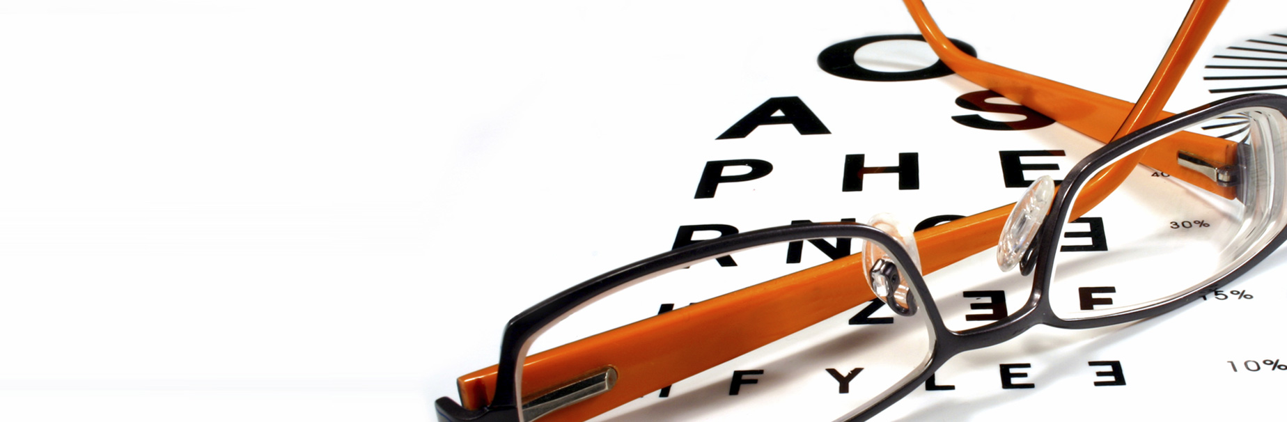 Orange and black glasses placed on an eye exam to show how FSA Administration can help your employees pay less for imporant expenses