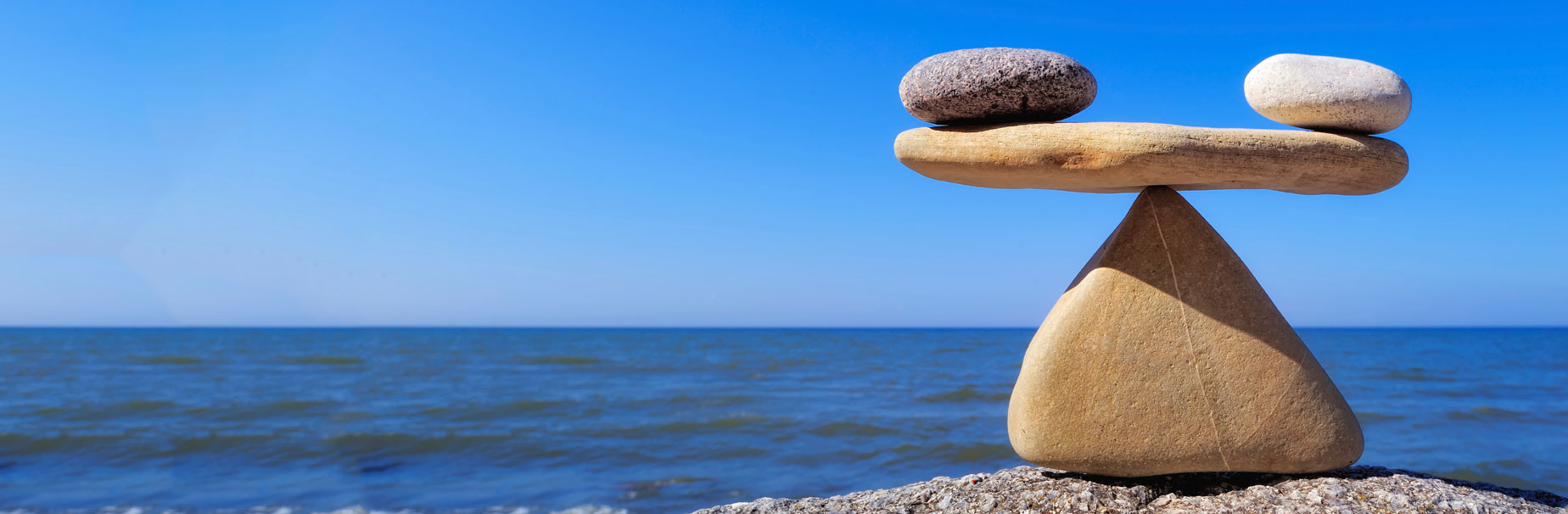 Rocks balanced on top of other rocks to show how HSA administrators can help your employees take control of health care costs