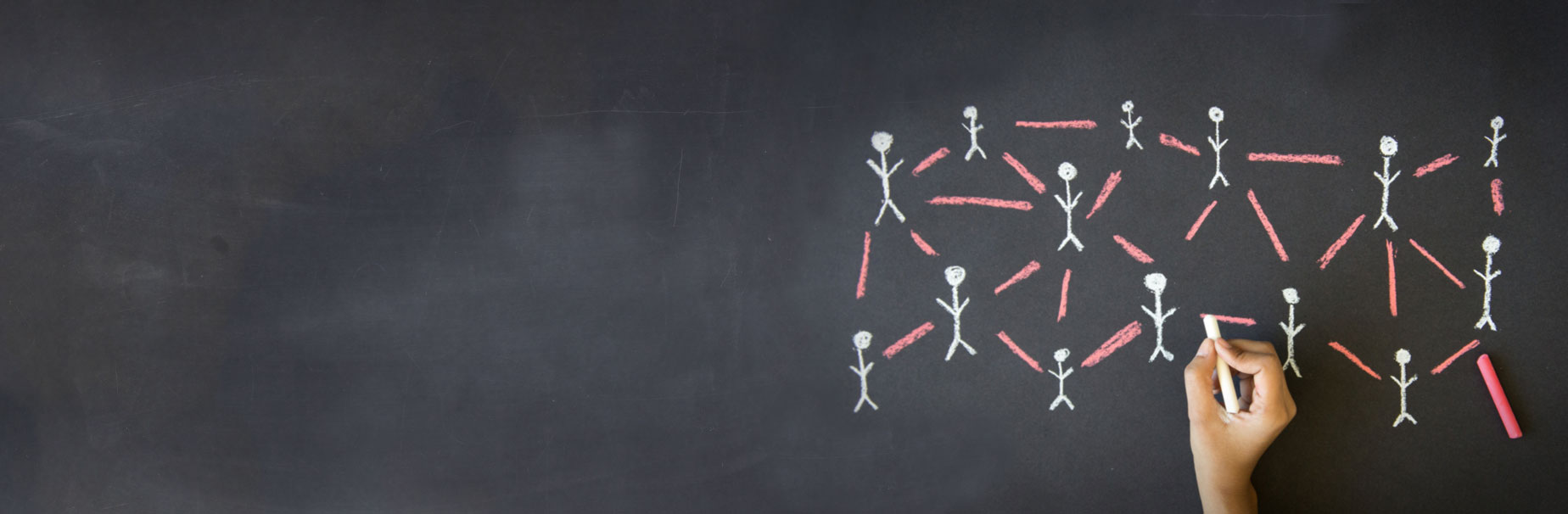 Person drawing people connected to one another on chalkboard to symbolize the importance of having Third Party Administrators