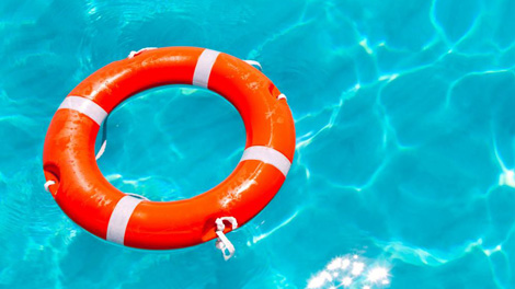 Life preserver in clear blue water to show how benefit enrollment saves time in employee benefit resources
