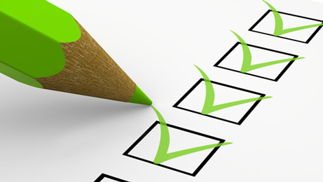 HSA checklist with green pencil in employee benefit resources