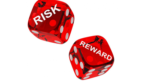Two die with the words risk and reward painted on to show trade offs of hiring a fiduciary services provider in employee benefit resources