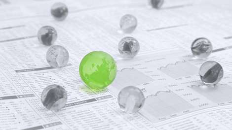 Small marbles made to look like globes on investment management reports to show them as important employee benefit resources