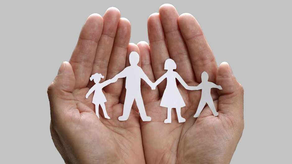 Hands holding paper family to show importance of a life insurance provider in employee benefit resources