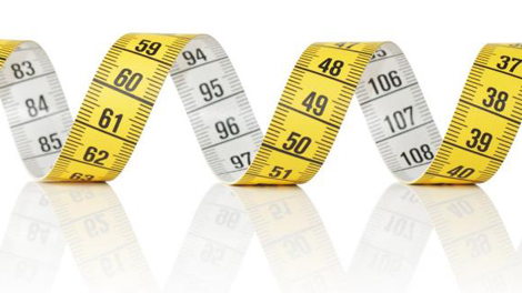 Tape measure swirled into design to symbolize retirement plan services benchmarks in employee benefit resources