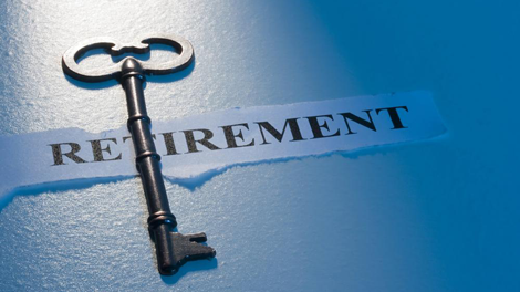 Old fashioned skeleton key on top of retirement paper to symbolize the importance of retirement plans for small business in employee benefit resources