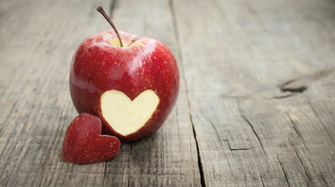 Apple with heart cut out of side to symbolize the importance of wellness programs in employee benefit resources
