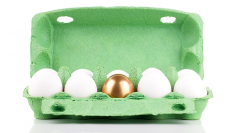 Green egg carton with golden egg to symbolize retirement shortfall retirement calculator