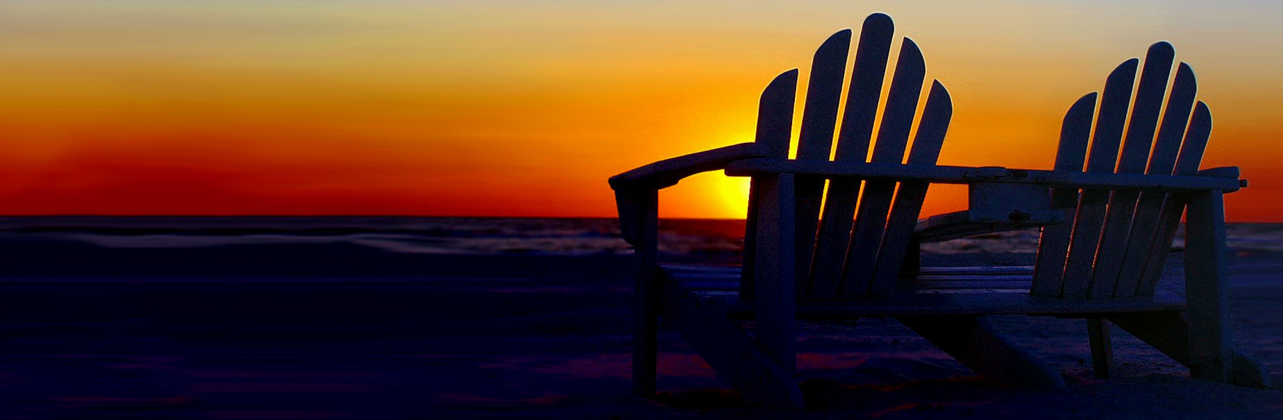 Two chairs with sunset in the background for retirement plan services